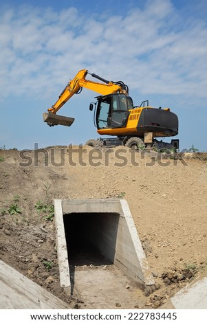 Construction site of new irrigation channel in field - stock photo