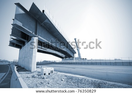 Construction site on highway, bridge under construction - stock photo