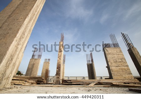 Construction site - Pillars of a building in the making against blue sky