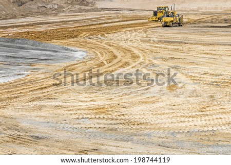 Construction site sandy soil wide open space, vehicles, and tire tracks. Curves and lines in the dirt. Horizontal photo.  - stock photo