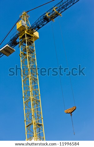 construction site series: yellow crane over blue sky