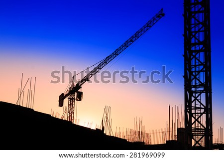 Construction site silhouette at sunset