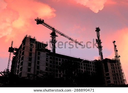 Construction Site silhouette in the sunset background - stock photo