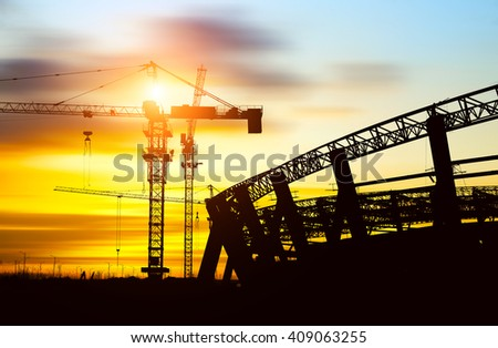 Construction site silhouette site steel structures and cranes. - stock photo