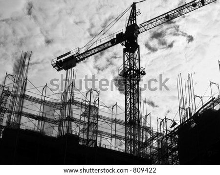 Construction Site Silhouette -- with crane and scaffolding - stock photo