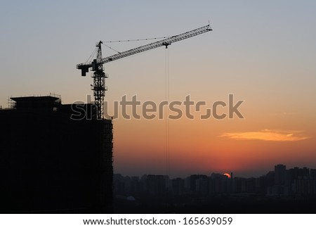 Construction site silhouettes in Beijing (China) after sunset  - stock photo
