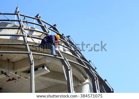 Construction site, the welding workers at work - stock photo