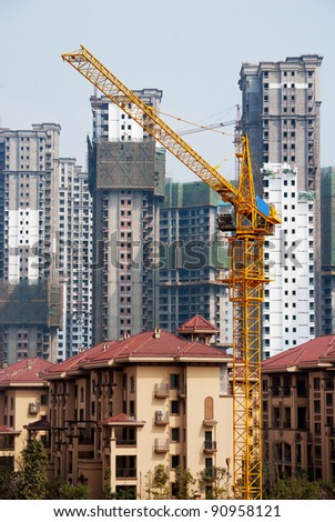 Construction site tower crane - stock photo