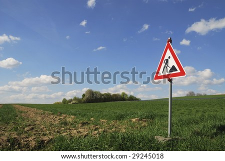 Construction site traffic sign in natural landscape