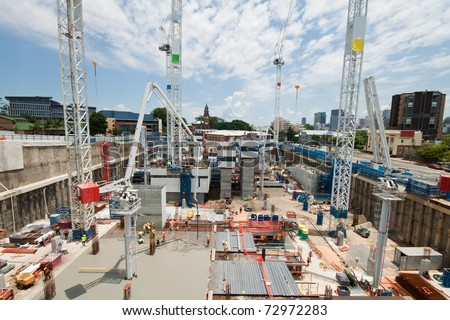 construction site with a few cranes at early stage (brisbane, qld, australia) - all logos and names removed - stock photo