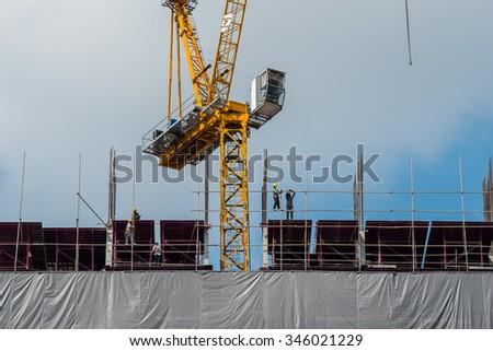 construction site with big crane - stock photo