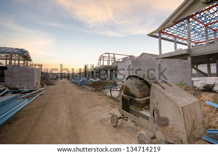 Construction Site with cement mill at Dusk - stock photo