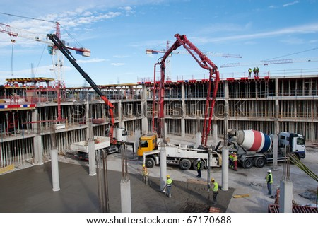 Construction site with cement mixer and blue sky - stock photo
