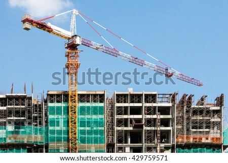 Construction Site with Crane against Blue Sky - stock photo