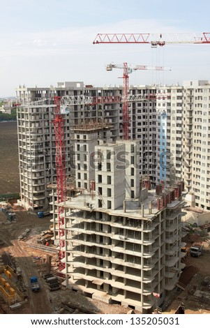 construction site with crane and building - stock photo