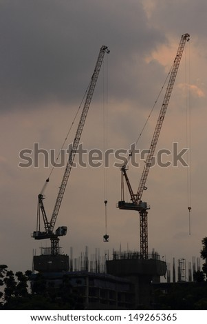 Construction site with crane and building in downtown of bangkok thailand