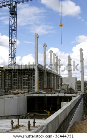 Construction site with crane and building's framework - stock photo
