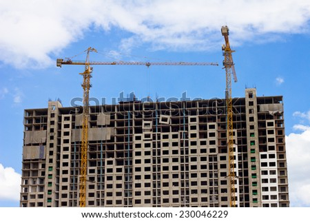 Construction site with cranes build large residential building on blue sky background at HUA HIN District, Popular attraction of Thailand
