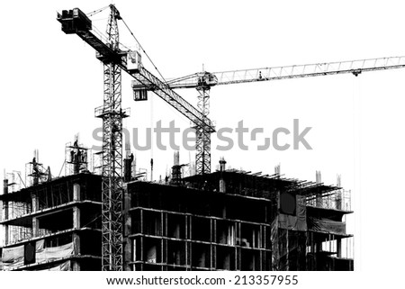 Construction site with cranes on silhouette background  - stock photo