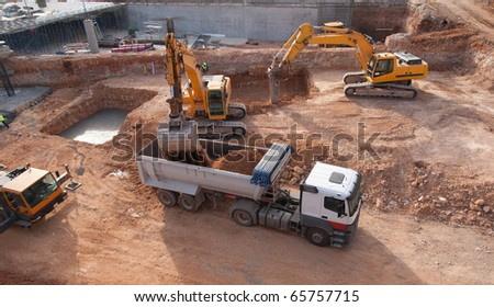 Construction site with dump truck - stock photo