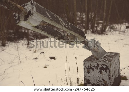 construction site with dust and snow - aged photo effect, vintage retro - stock photo