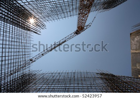 Construction site with enforced concrete steel frames rising up - stock photo