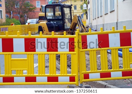 Construction site with excavator / Construction site - stock photo