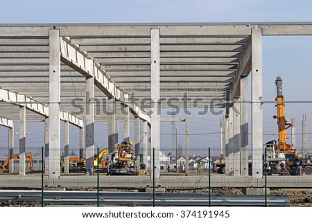 construction site with machinery and workers - stock photo