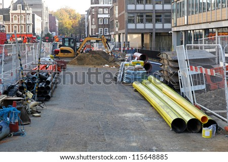 Construction site with material and machinery in the city - stock photo