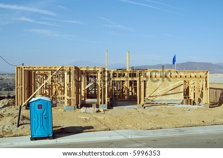 Construction site with new homes and outhouse. - stock photo