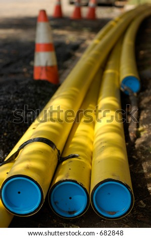 construction site with piping and traffic cones - stock photo