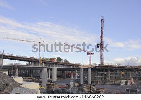 Construction site with roads and bridges under construction - stock photo