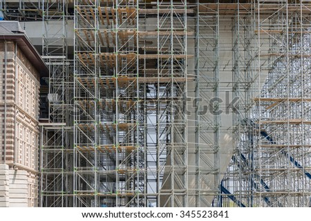 Construction site with scaffolding of a big modern office building - stock photo