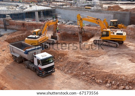 Construction site with tractors and dump truck - stock photo