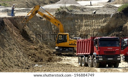 Construction site with tractors and dump truck in Sofia, Bulgaria May 15, 2005