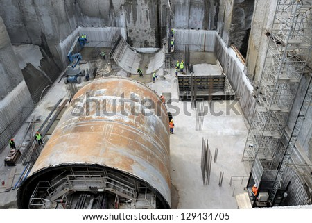 Construction site with tunnel digging machine building metro - stock photo