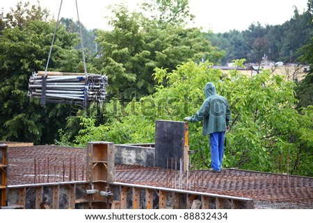 construction site with worker working planks metal wall