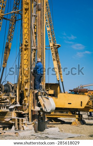 Construction site with workers and hydraulic drilling machines - stock photo