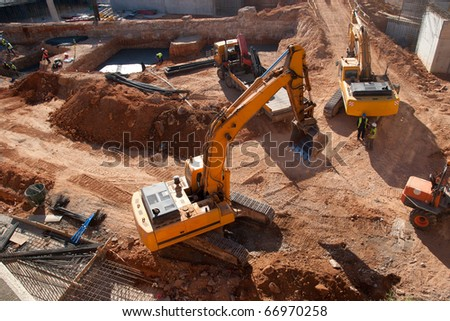 Construction site with yellow tractors - stock photo