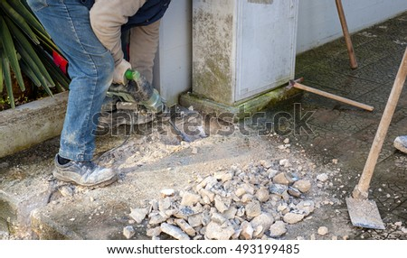 Construction site - worker using Jackhammer.