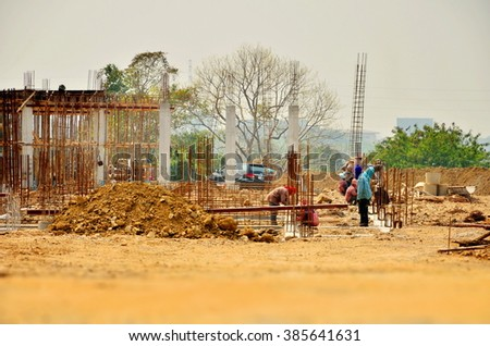construction site workers for office building at thailand - stock photo