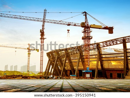 Construction sites, cranes and huge steel structure.