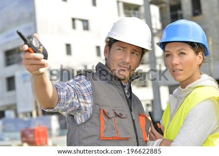 Construction team on building site - stock photo