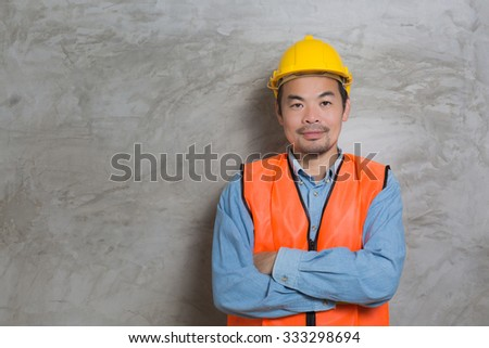 construction technician wearing hard hat and safety vest