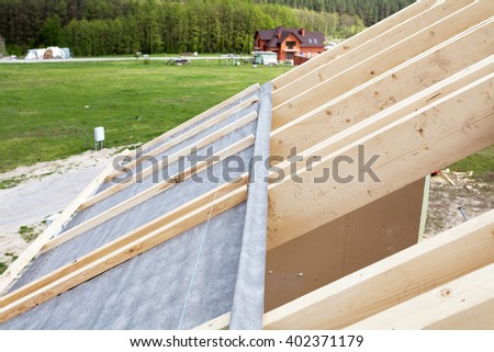Construction the roof of a new house. Waterproof layering - stock photo