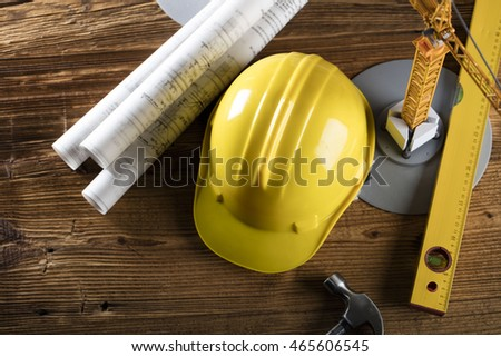 Construction theme, level, cranes,  ruler, calculator, blueprints rolls, hard hat and pencil