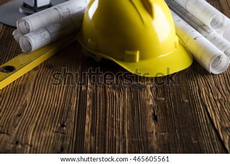 Construction theme, level, ruler, , cranes, calculator, blueprints rolls, hard hat and pencil