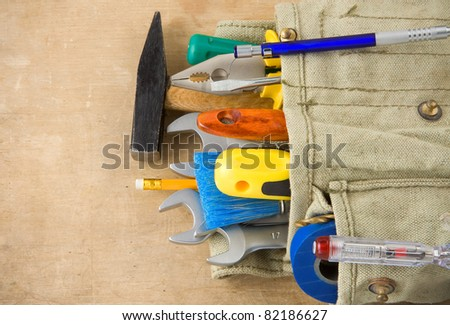 construction tools and bag on wood texture