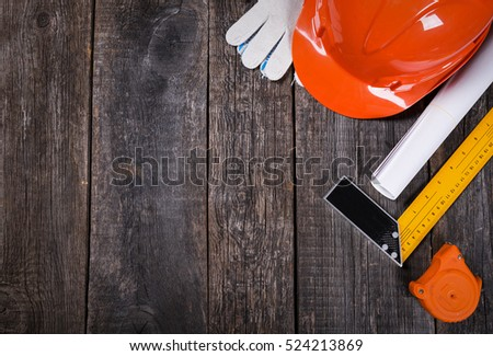 Construction tools closeup on wooden background