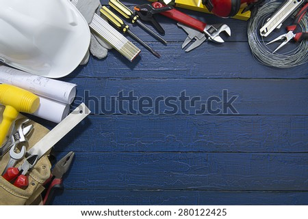 Construction Tools on Blue Wood.  - stock photo